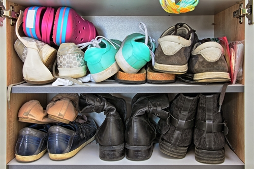 Putting footwear in a storage unit